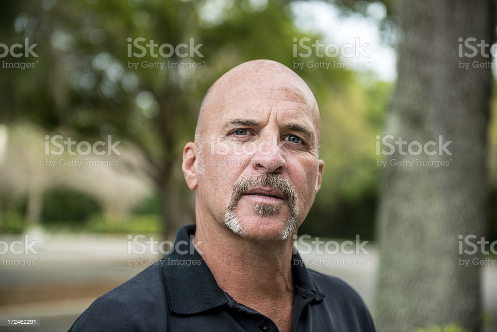 Portrait of a Caucasian Bald Man Outside royalty-free stock photo