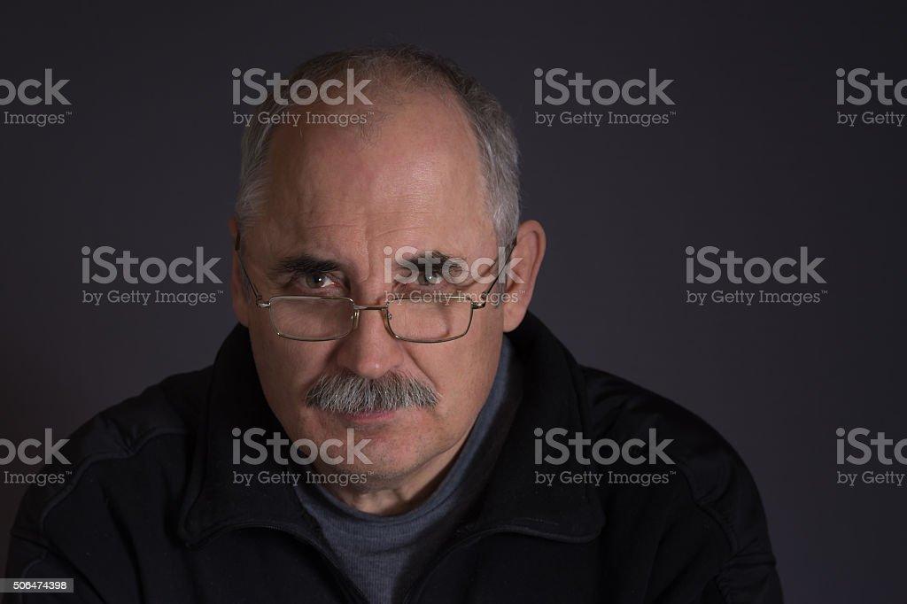 Portrait of a Caucasian man against dark background stock photo