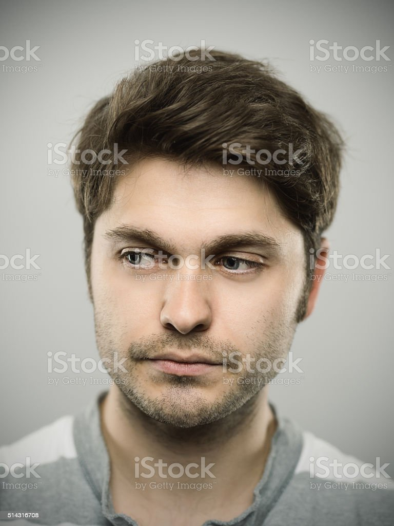 Portrait of a caucasian real young man. stock photo