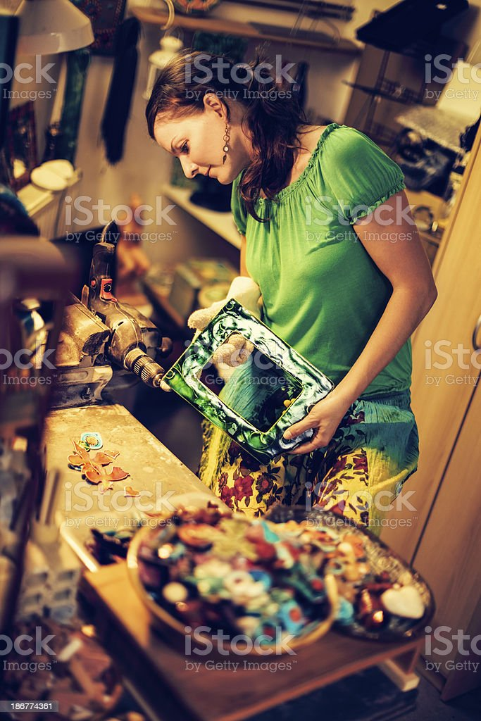 Portrait of a ceramist in her own workshop royalty-free stock photo