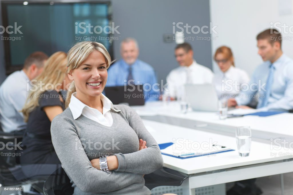 Portrait of a cheerful businesswoman at the office. stock photo