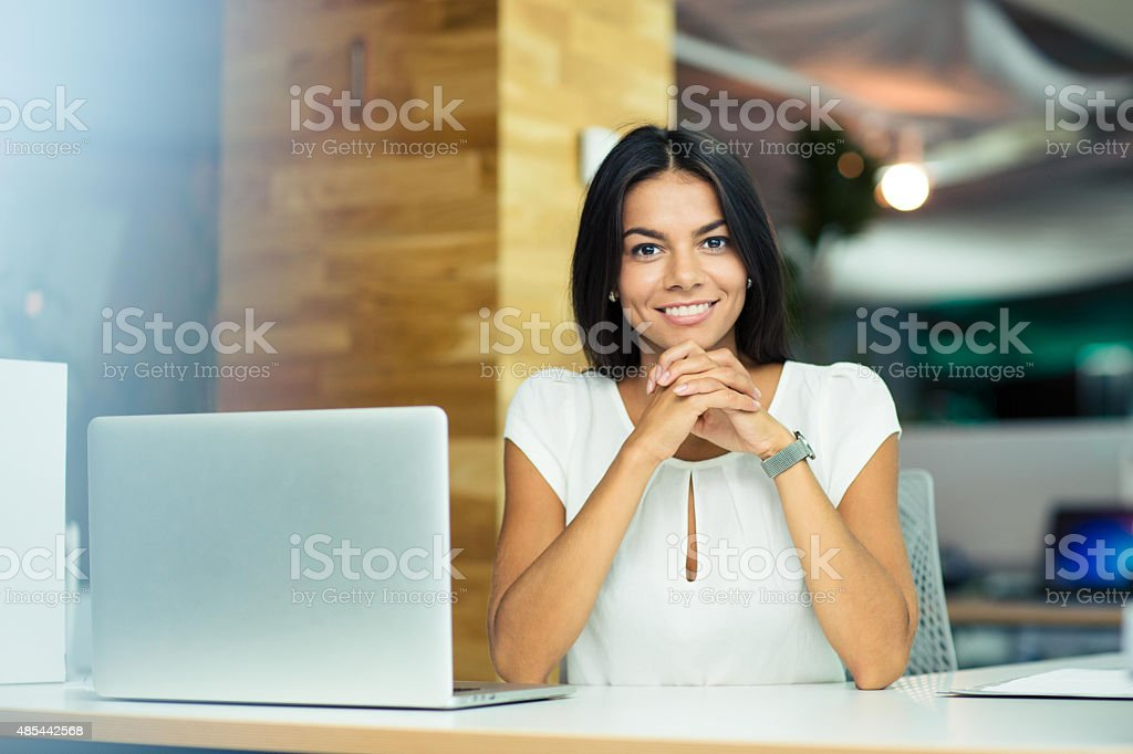 Portrait of a cheerful businesswoman in office stock photo