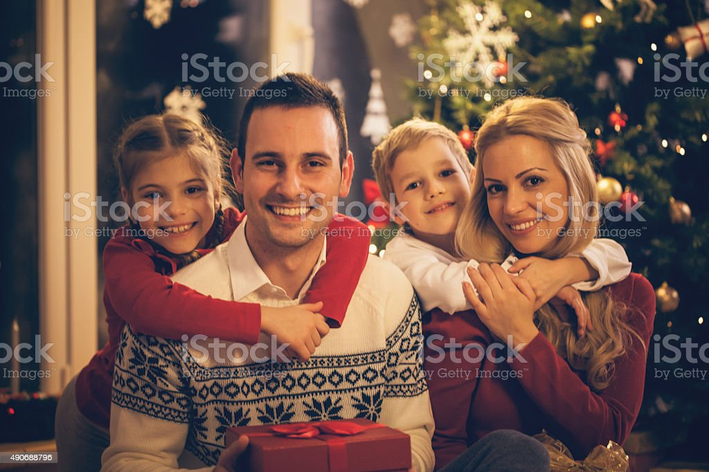 Portrait of a cheerful family celebrating Christmas stock photo