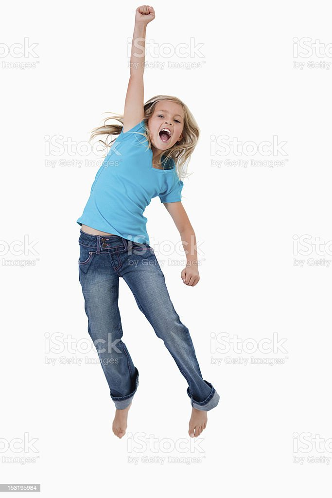 Portrait of a cheerful girl jumping stock photo