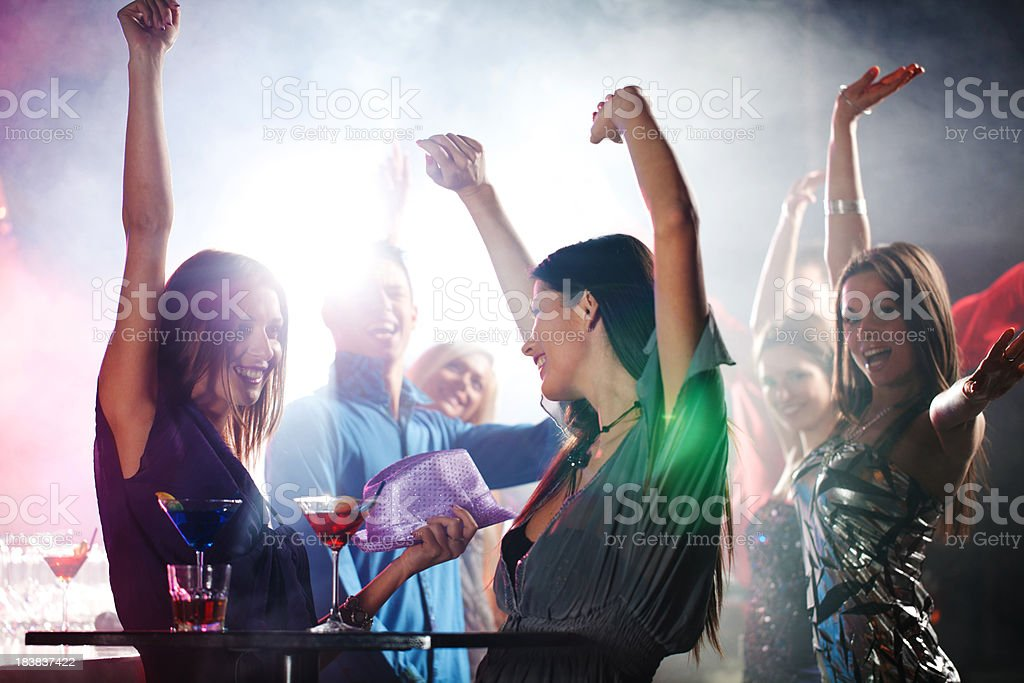 Portrait of a cheerful girls dancing at party. royalty-free stock photo
