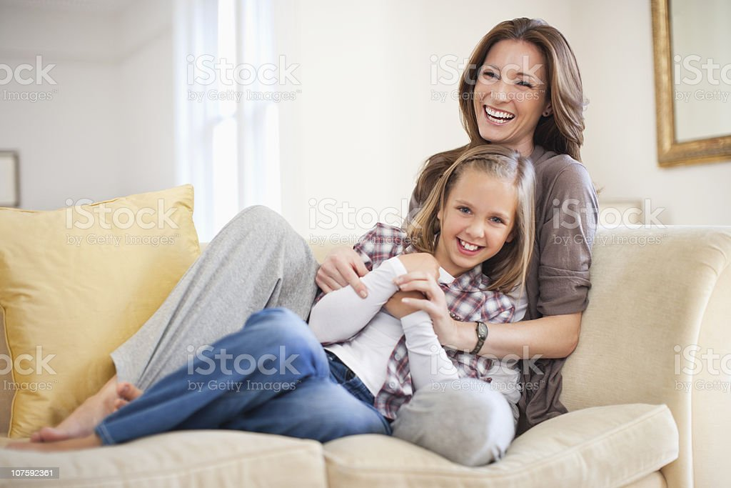 Portrait of a cheerful mother with daughter (8-9) at home royalty-free stock photo