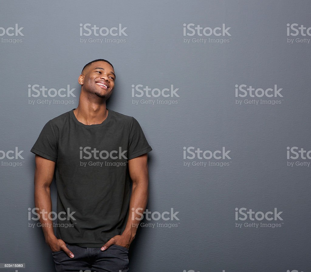 Portrait of a cheerful young man smiling stock photo