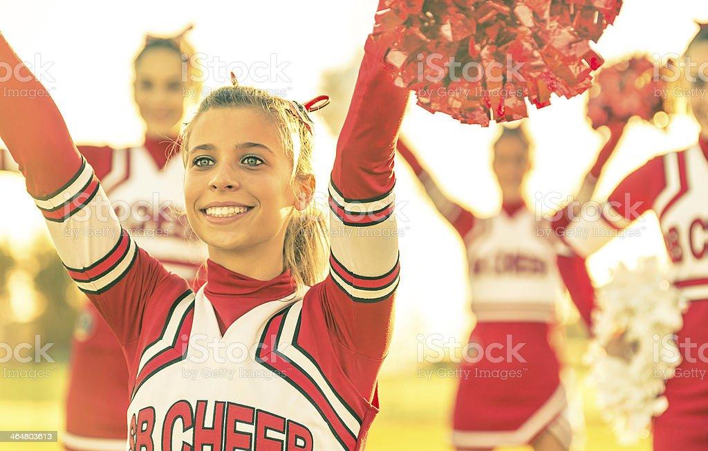 Portrait of a cheerleeder in action stock photo