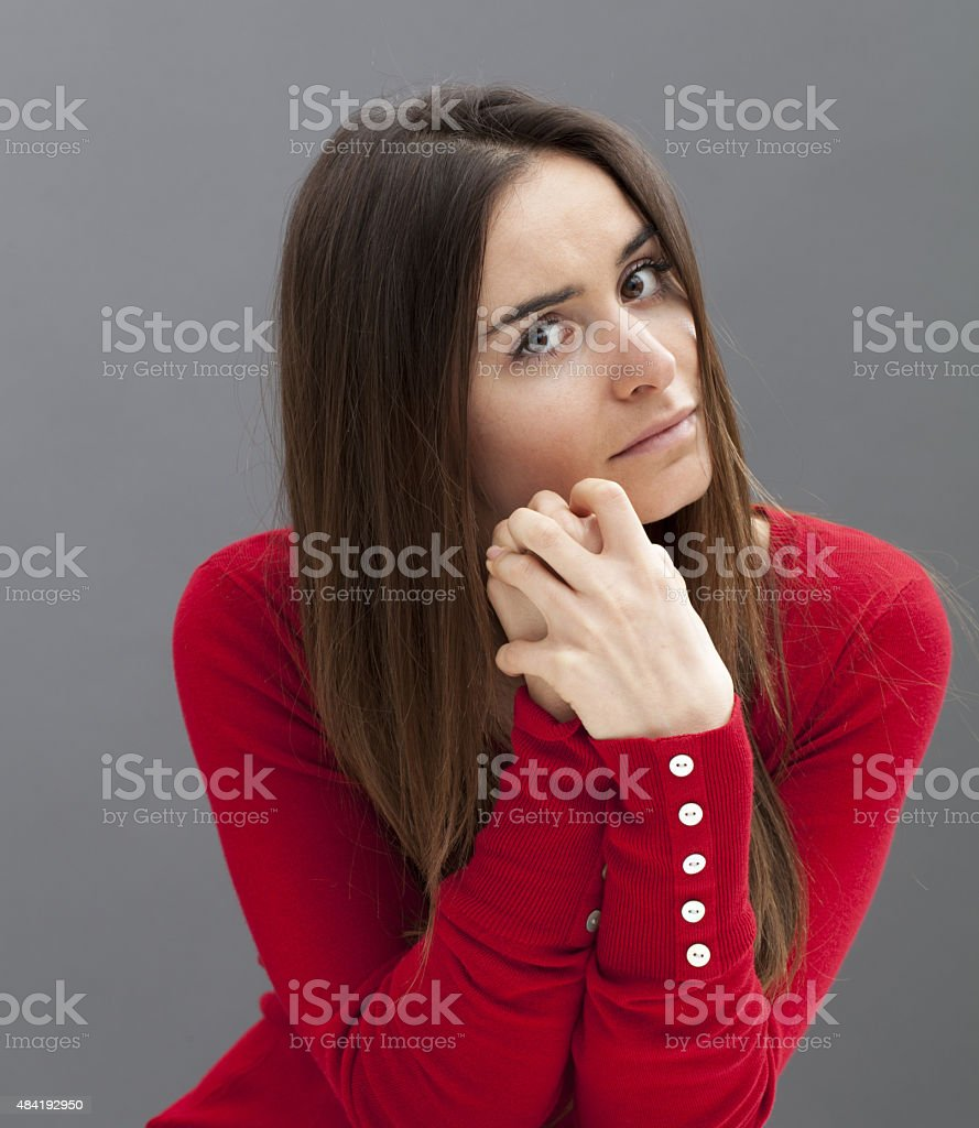 portrait of a concerned young woman stock photo