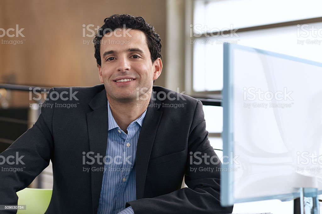 Portrait of a confident businessman at work in his glass stock photo