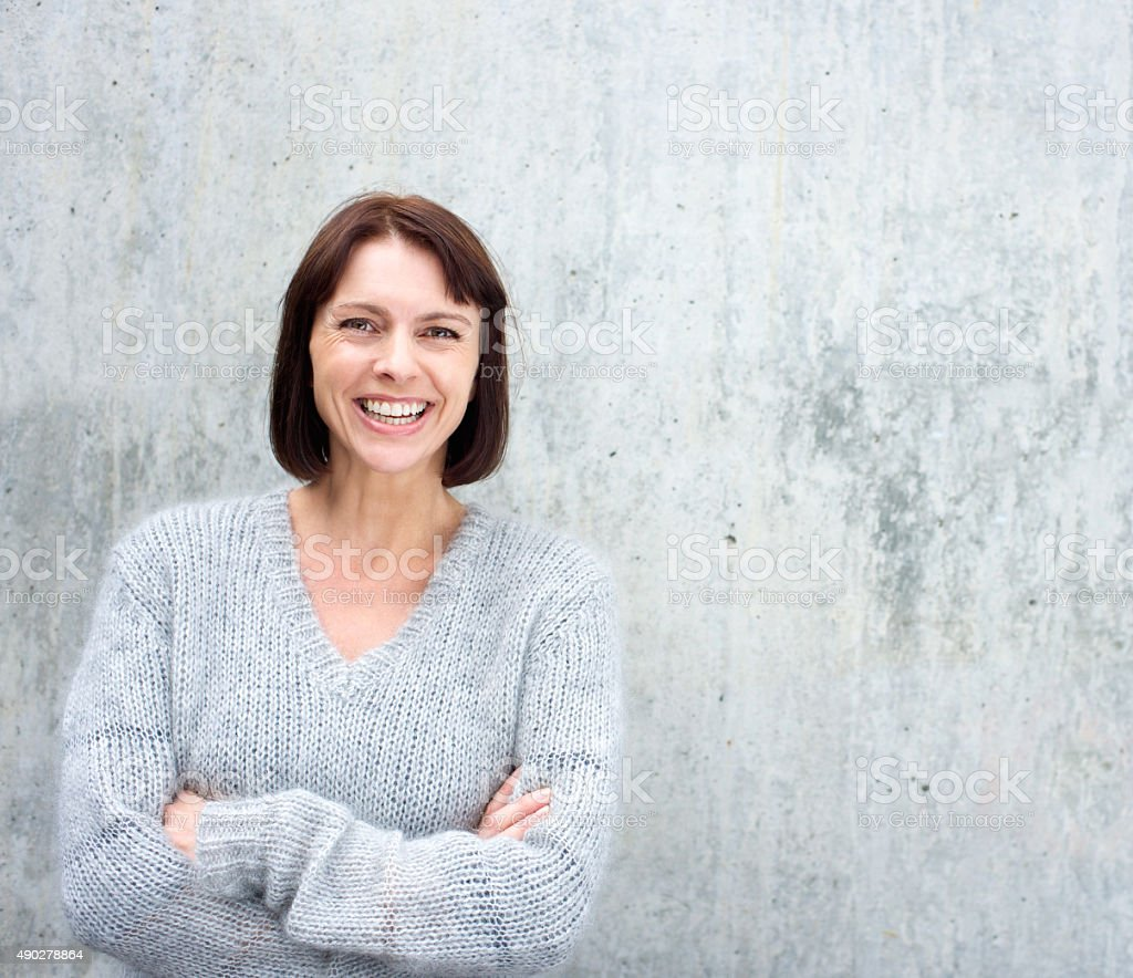 Portrait of a confident older woman smiling stock photo