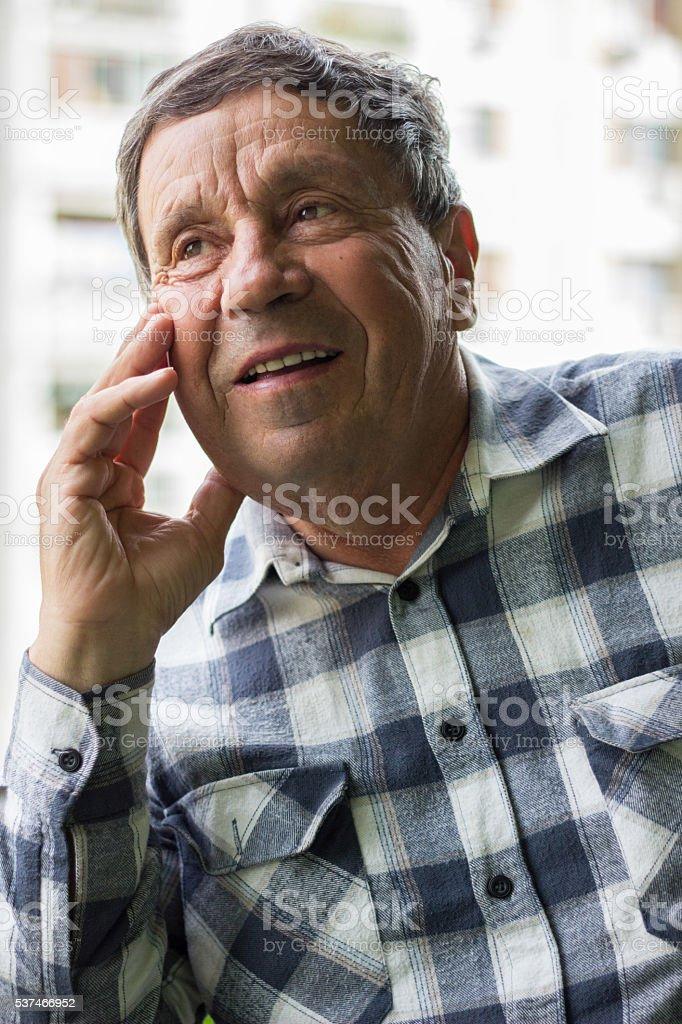 Portrait of a confident senior man smiling stock photo