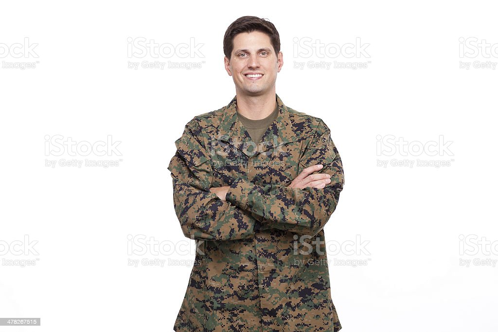Portrait of a confident young soldier posing with arms crossed royalty-free stock photo