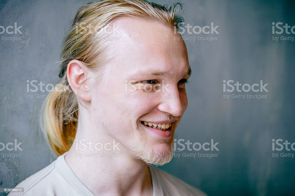 Portrait of a cool and cheerful young man stock photo