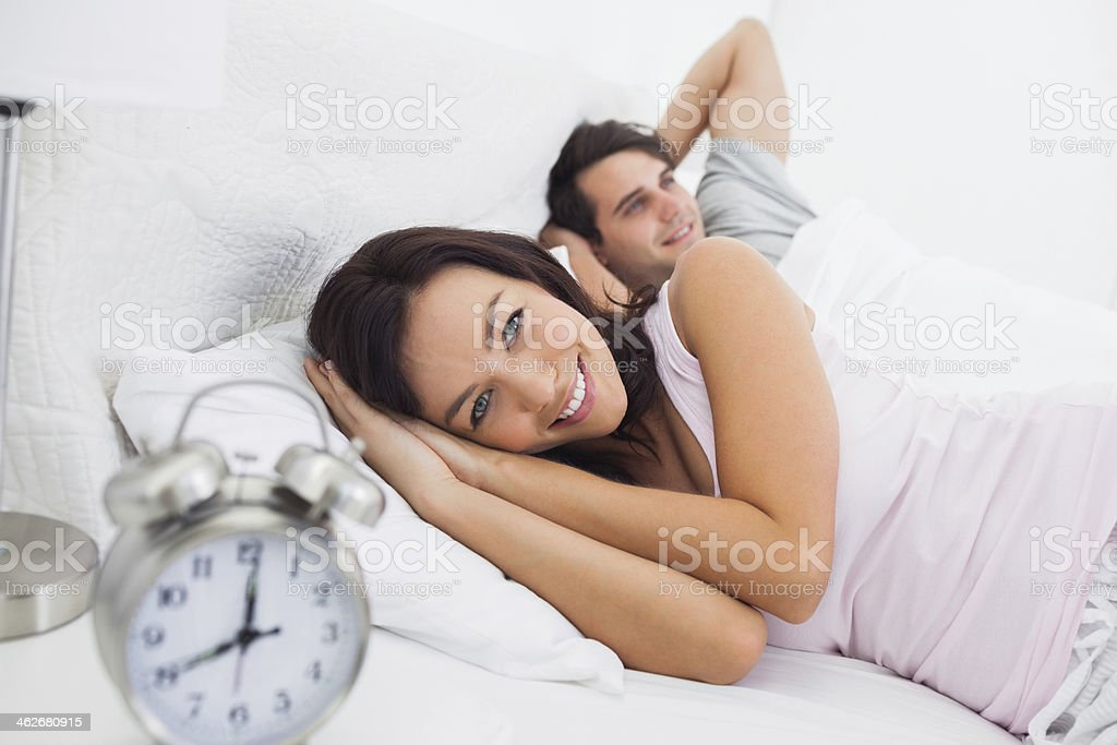 Portrait of a couple in bed stock photo