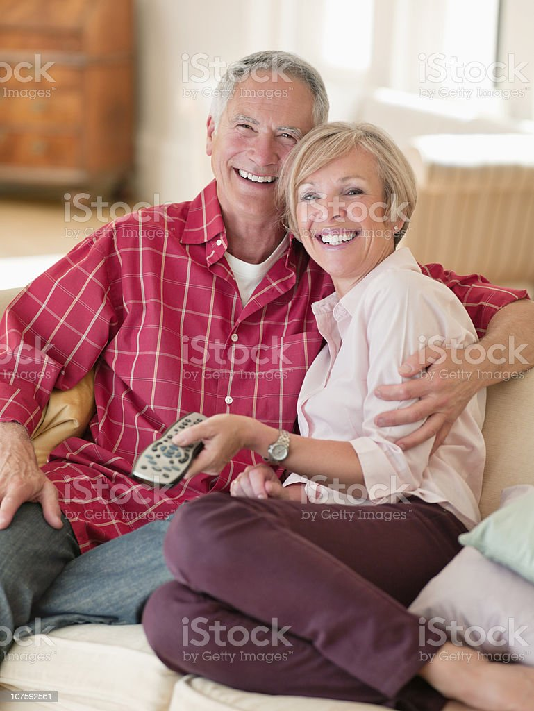 Portrait of a couple watching television, smiling royalty-free stock photo