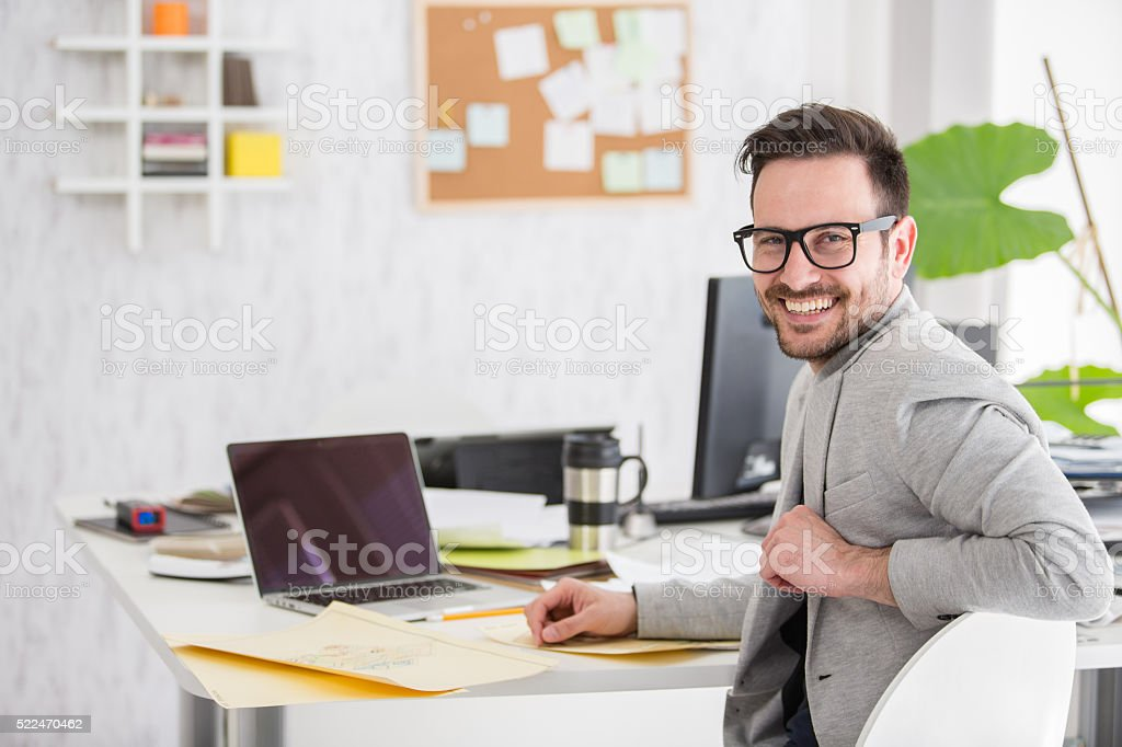 Portrait of a creative office worker at desk stock photo