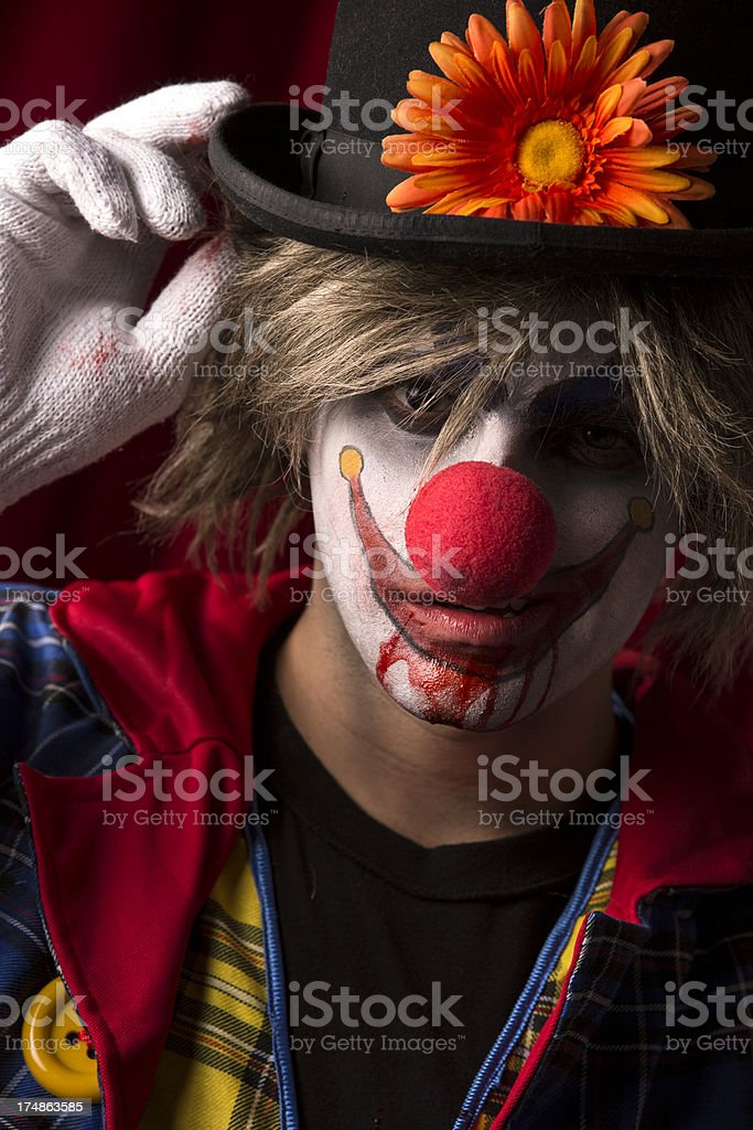 Portrait of a Creepy Clown Tipping His Hat royalty-free stock photo