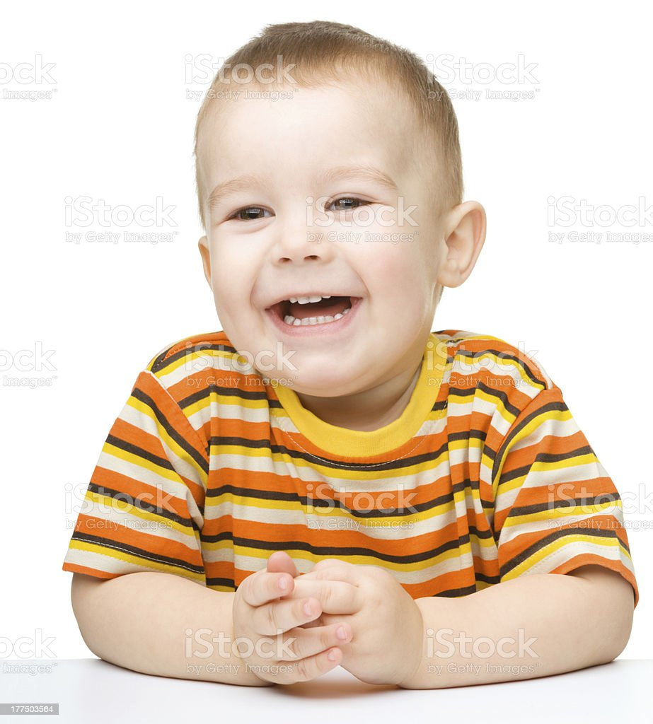 Portrait of a cute and cheerful little boy stock photo