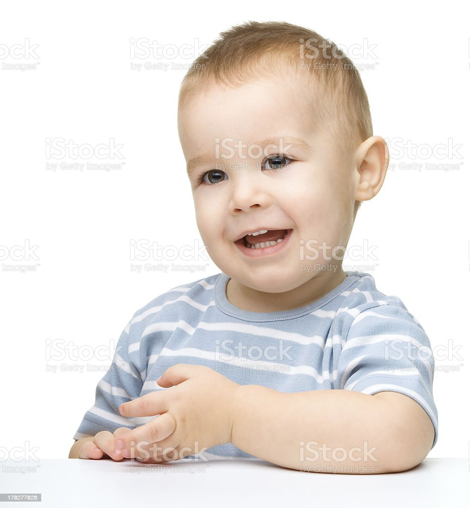 Portrait of a cute and happy little boy stock photo