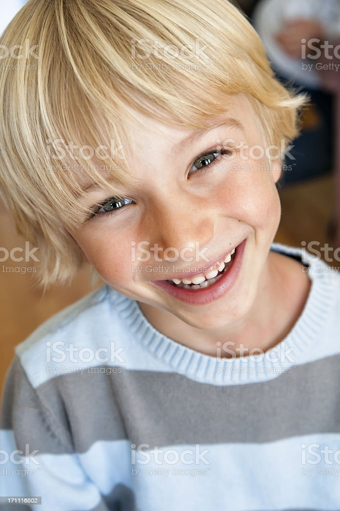 Portrait of a cute and happy young boy. stock photo