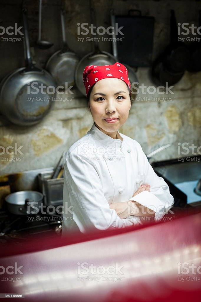 Portrait of a Cute Asian Female Cook in the Kitchen stock photo