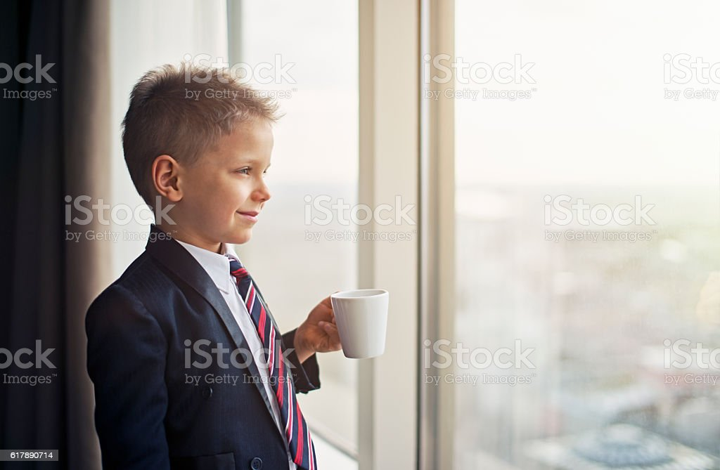 Portrait of a cute little business man stock photo