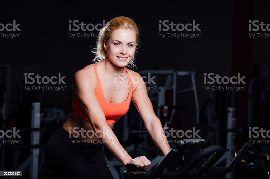 Portrait of a cute nice female workout on  fitness  the stock photo
