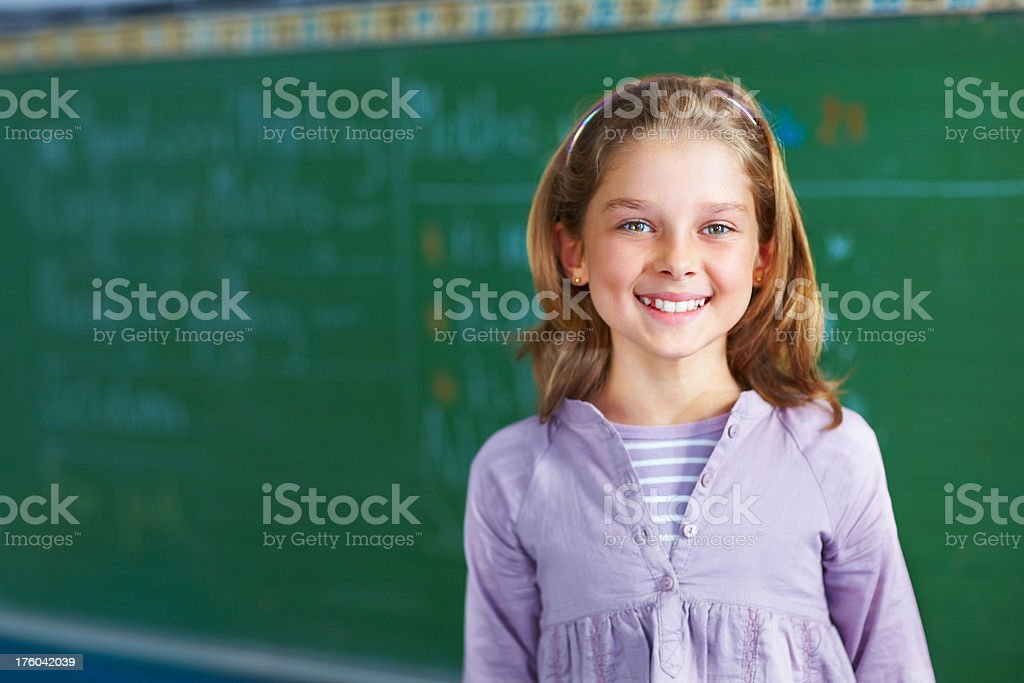 Portrait of a cute schoolgirl smiling royalty-free stock photo