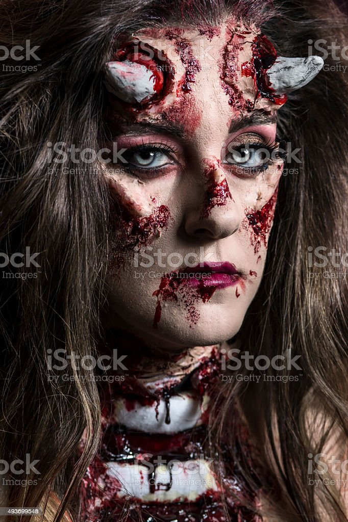 Portrait of a devil with horns stock photo