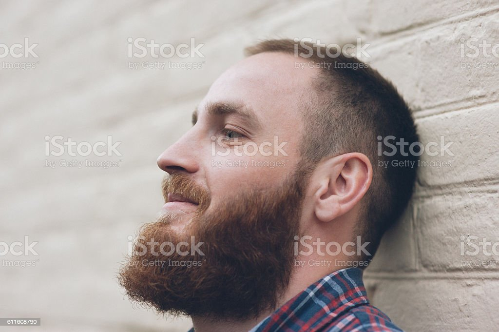 portrait of a dreaming man with beard stock photo