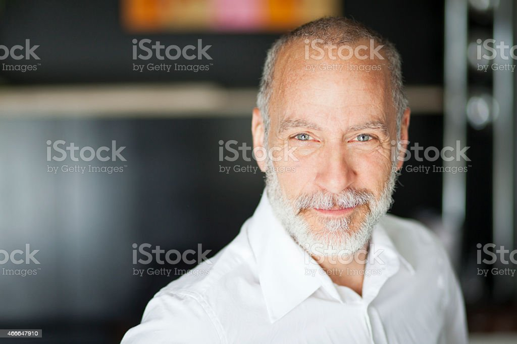 Portrait Of A Elderly Man Smiling At The Camera stock photo