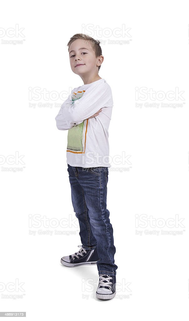 Portrait of a elementary boy with arms crossed stock photo