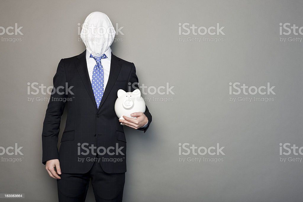 portrait of a faceless man keeping money box stock photo