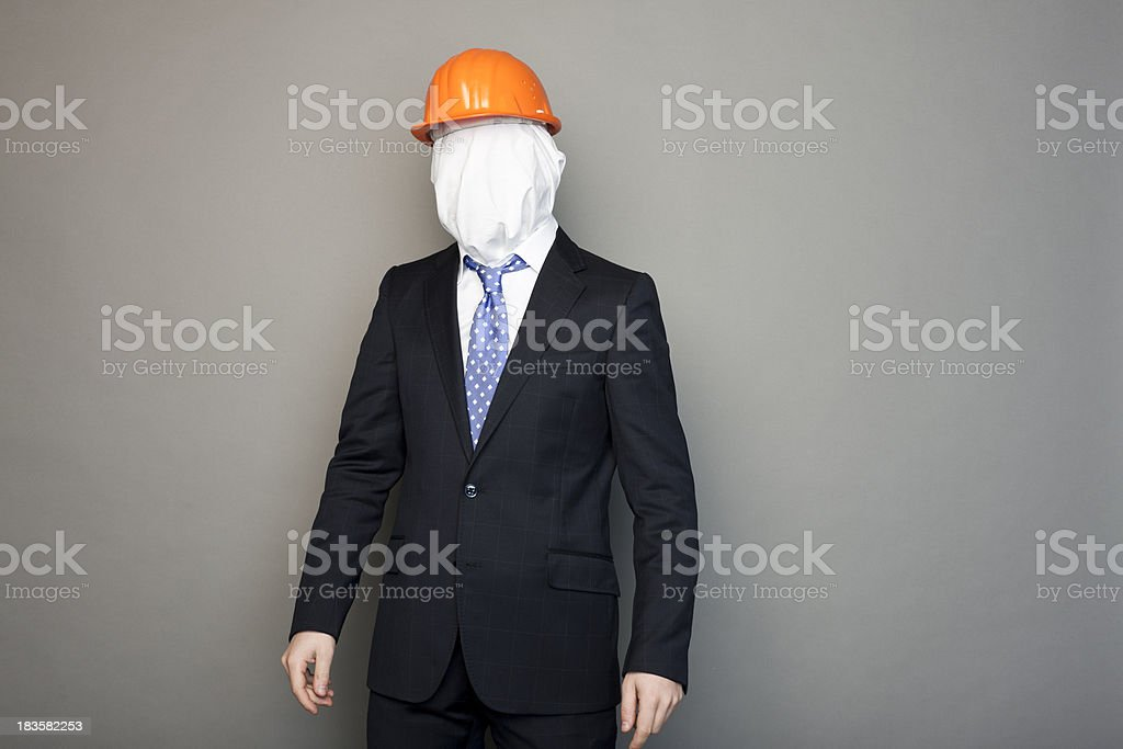 portrait of a faceless man wearing construction cap stock photo
