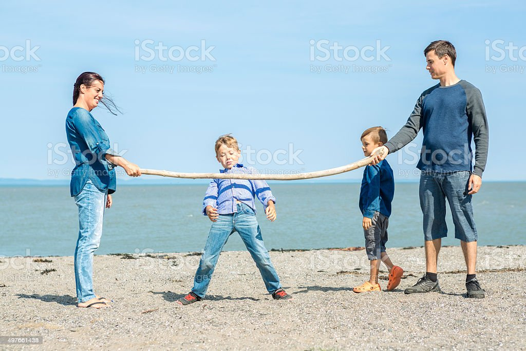 Portrait of a Family having fun at the beach stock photo