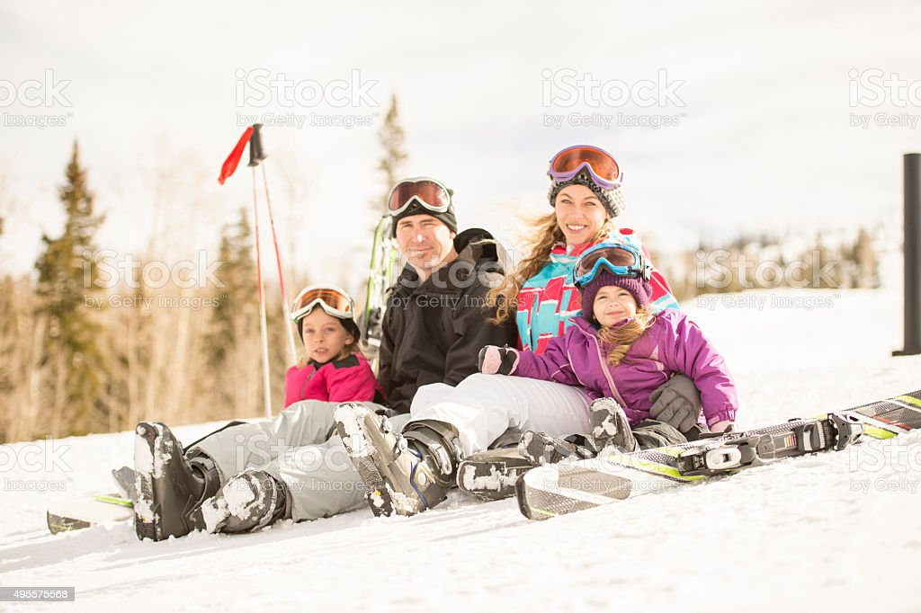 Portrait of a Family on a Ski Hill stock photo