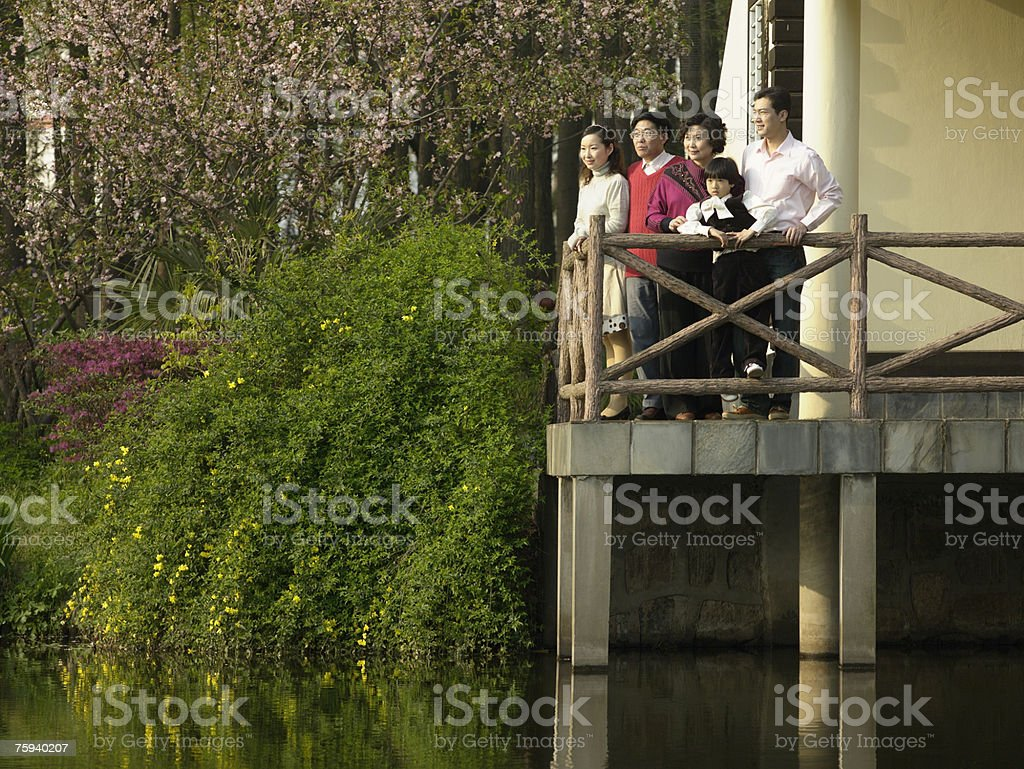 Portrait of a family on a terrace royalty-free stock photo