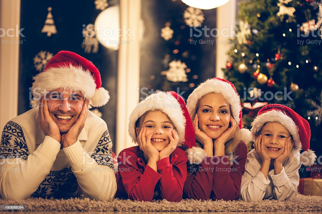 Portrait of a family wearing Christmas hats stock photo