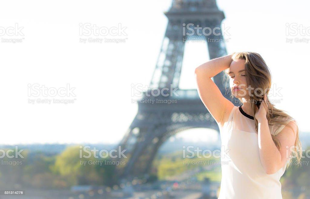 Portrait of a fashion model near Eiffel Tower stock photo
