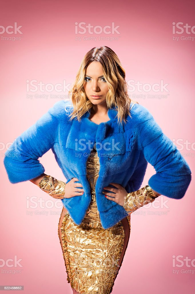 Portrait of a fashionable woman on pink background stock photo