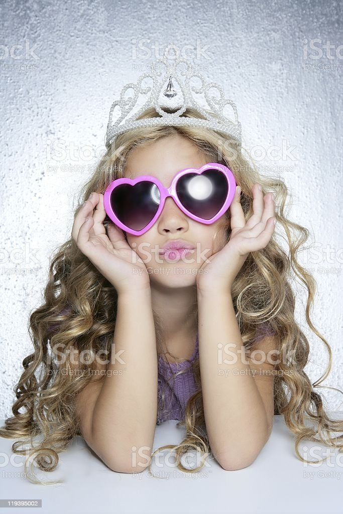 Portrait of a fashionista little girl with a princess crown stock photo