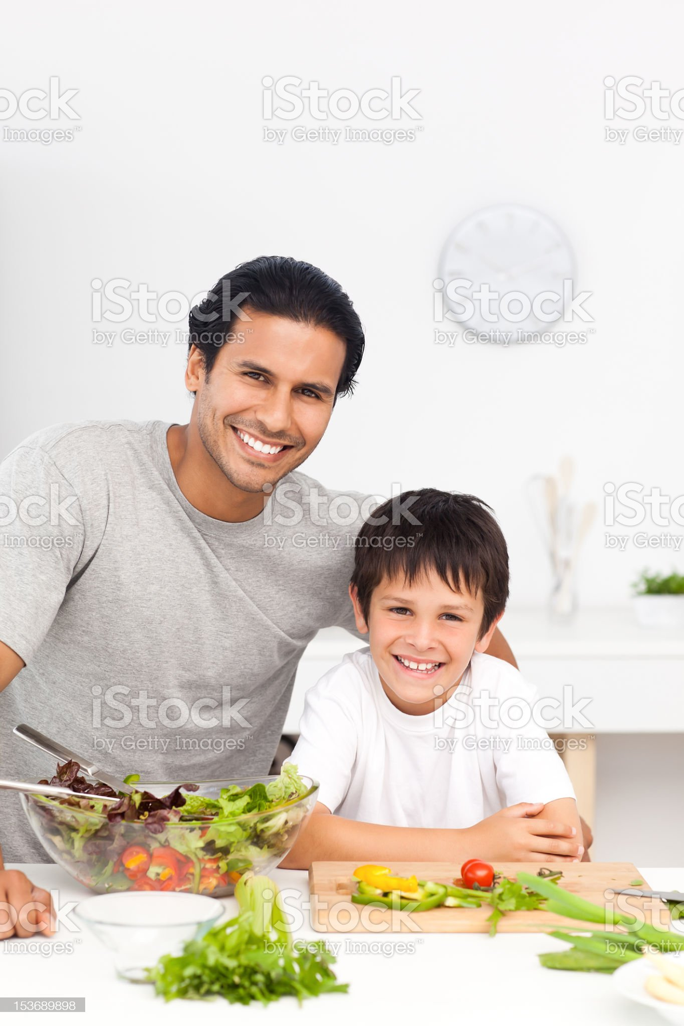 Portrait of a father and his son preparing their lunch royalty-free stock photo