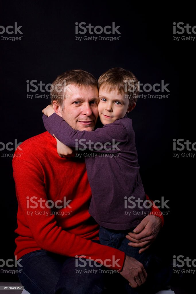 portrait of a father with his son stock photo
