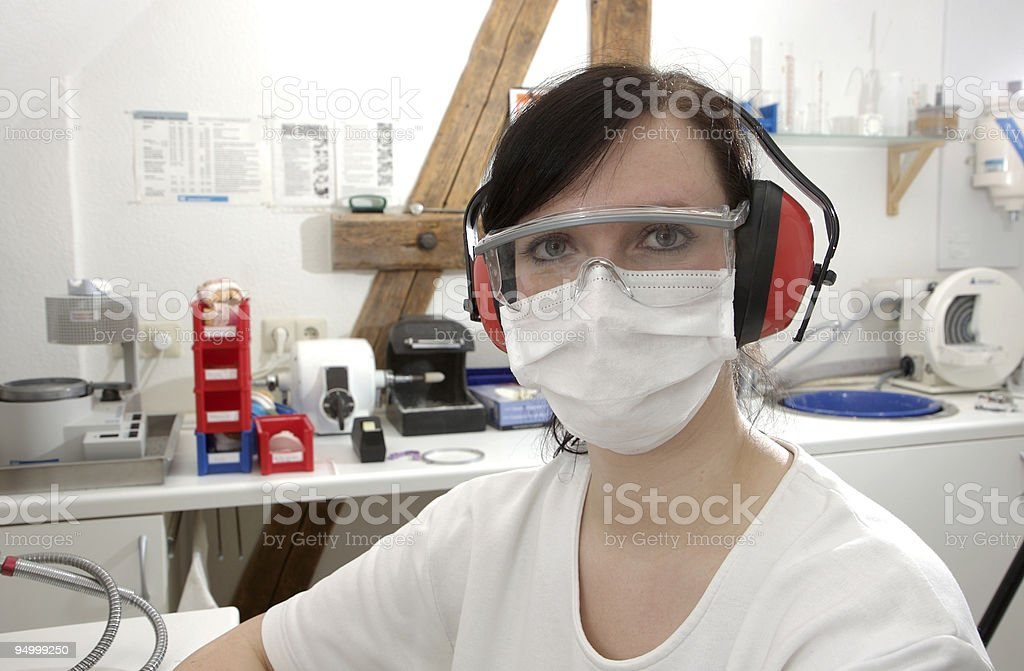 portrait of a female dental technician with surgical mask stock photo