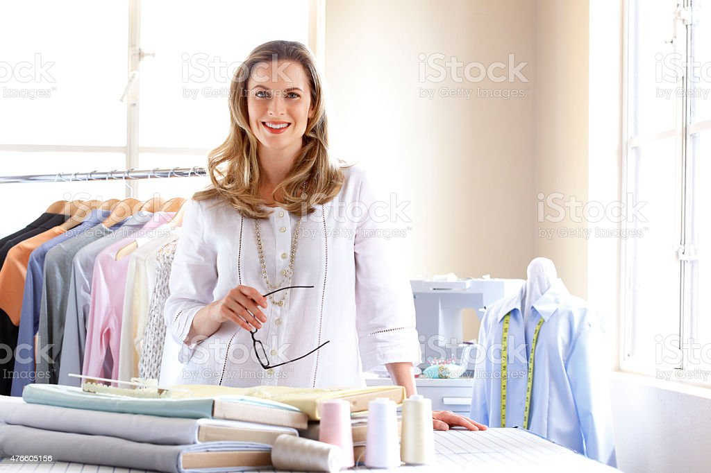 Portrait of a female Dressmaker Working In Her Studio stock photo