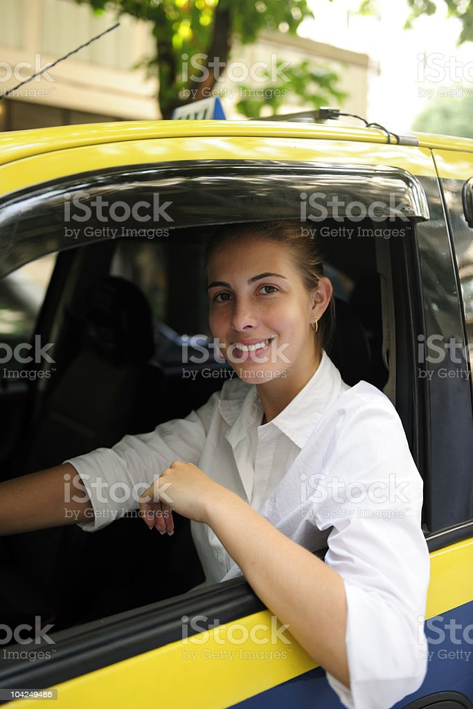 Portrait of a female taxi driver stock photo