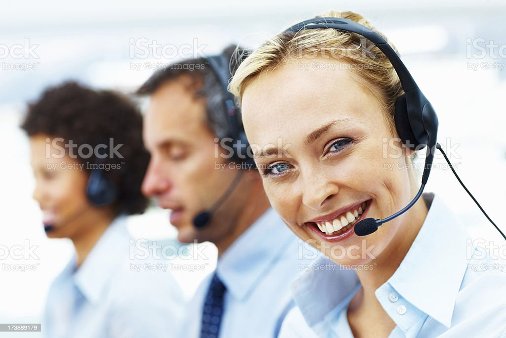 Portrait of a female telephonist smiling royalty-free stock photo