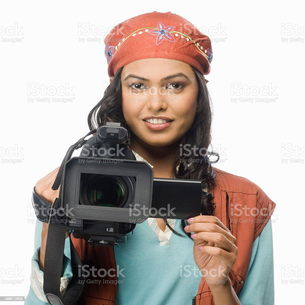 Portrait of a female videographer video graphing stock photo