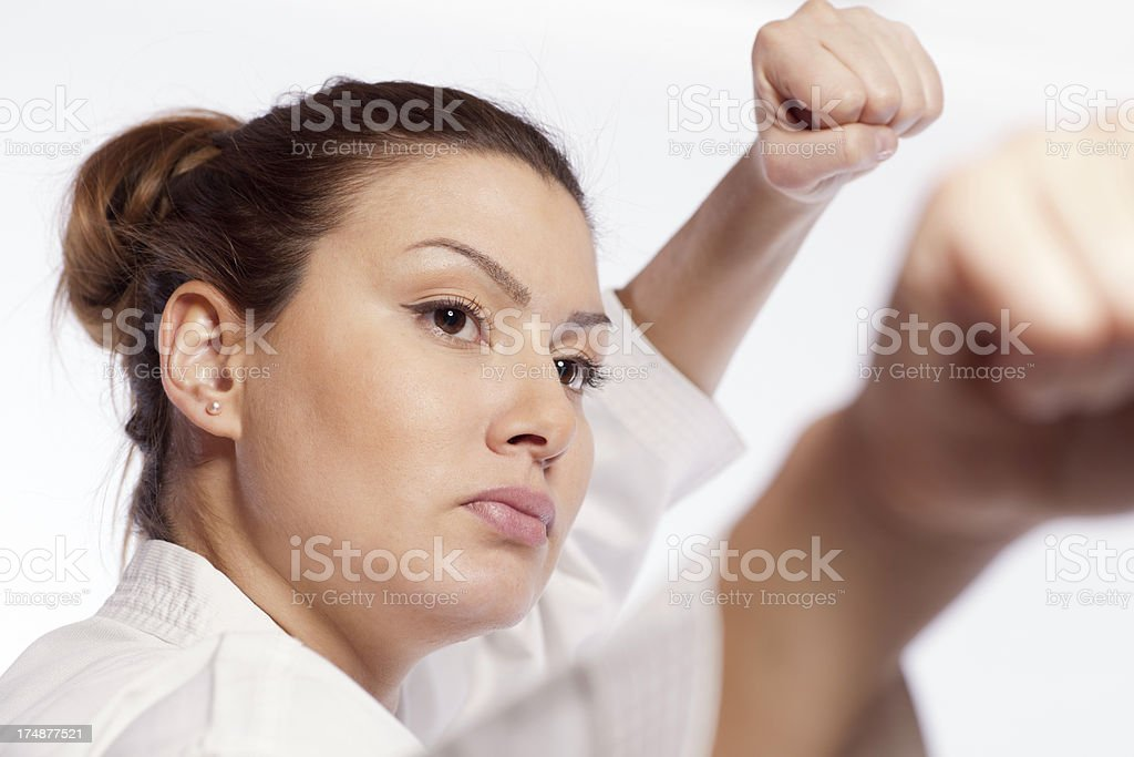 Portrait of a fighting woman making Taekwando royalty-free stock photo